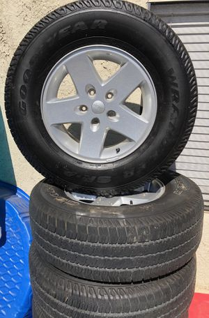 """Stock Jeep 17"""" rims and tires for Sale in Industry, CA"""