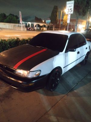 Toyota Corolla 94 with rines d nissan 240 for Sale in Los Angeles, CA