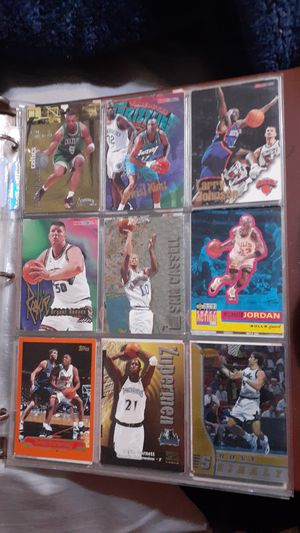 370 nba cards and 70 baseball cards in a album book for Sale in Sebring, FL