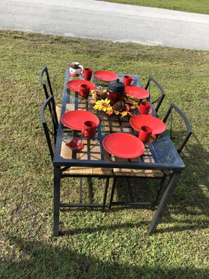 Black table with red dishes for Sale in Winter Haven, FL