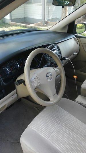 Mazda 2004 minivan for Sale in Denver, CO