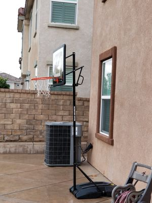 Basketball adjustable hoop w/ wheels like new for Sale in West Covina, CA