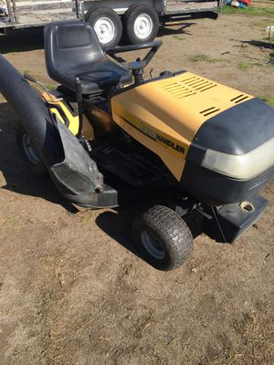 Riding lawn mower, penny's , 12.5 Briggs-Stratton engine, six speed , easy to drive, mows nice, slow leak right front tire, half a bagger system just for Sale in Tacoma, WA