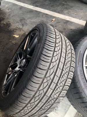 18 inch black/charcoal rims with Pirelli tires for Sale in Visalia, CA
