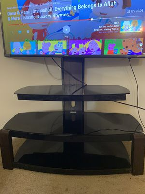 Glass tv stand (tv is not included ) for Sale in Laurel, MD
