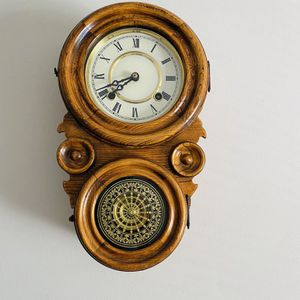 Unique Antique oak wind _up wall clock with key and brass pendulum for Sale in Germantown, MD