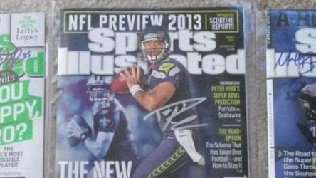 Collection of THREE Seahawks AUTOGRAPHED Sports Illustrated & DOZENS more items posted here for Sale in Kirkland,  WA