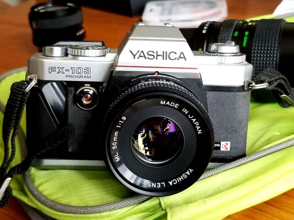 35mm FILM SLR camera YASHICA with 3 Lenses, great for photo 101. Venmo
