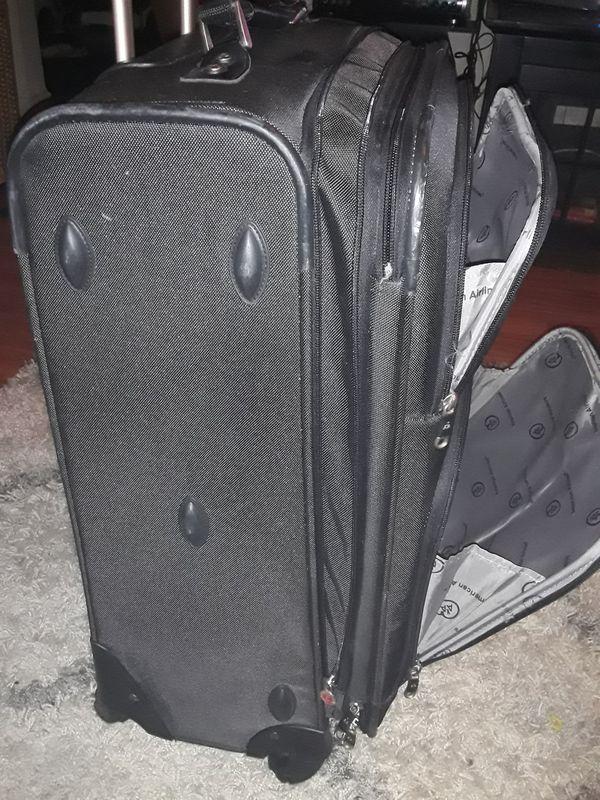 Black luggage rolling bag