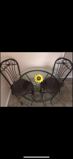 Round glass table and 2 cushioned chairs for Sale in New Hyde Park, NY