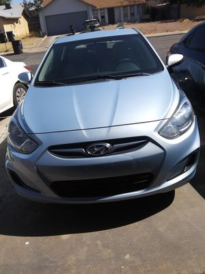Hyundai accent hatchback 2013 6 speed Dealer Rebuilt Title for Sale in Henderson, NV