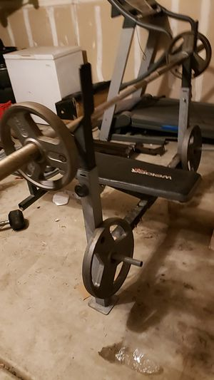 Bench and Olympic bar plus weights for Sale in Visalia, CA