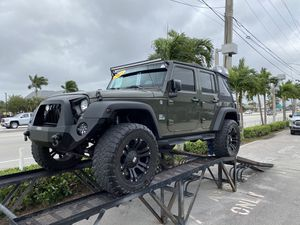 2015 JEEP WRANGLER UNLIMITED V6 , 6 speed manual , 51k Miles , LIFTED W/CUSTOM WHEELS, CLEAN CAR FAX RUNS LIKE NEW !!!! FINANCING AVAILABLE TO ANYONE for Sale in West Palm Beach, FL