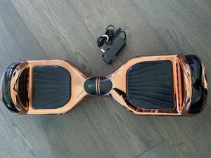 Hoverboard in Rose Gold w/ Bluetooth Speakers for Sale in Austin, TX
