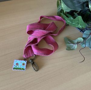 Natural Life Pink Lanyard ID Wallet w/ Flower Charm for Sale in El Cajon, CA