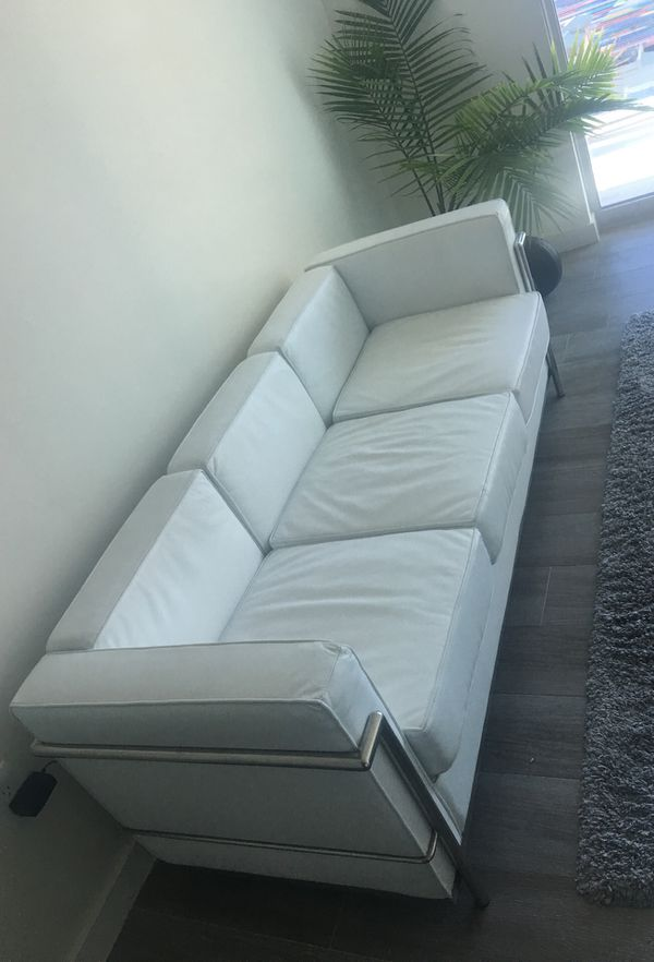 Mid century modern white leather couches and chair.