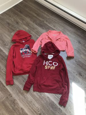 Two pair of hoodies and a crop top / quarter selves coral denim jacket for Sale in Baltimore, MD
