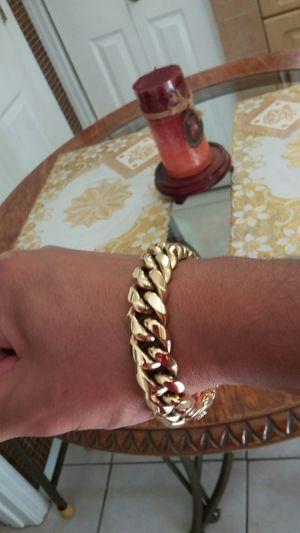 Very nice 14kt gold over stainless steel 12mm by 9inch long Miami Cuban link bracelet for sale !! for Sale in Tampa, FL
