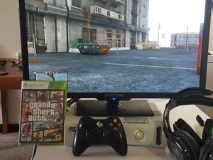 Xbox 360 15GB, One Battery Operated Controller, One Game (GTA 5) , Two Head Sets for Sale in Cleveland, OH