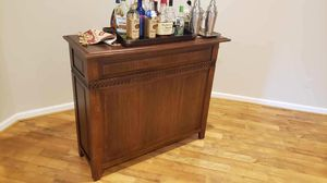 Dark solid wood bar and wine rack for Sale in Aldie, VA