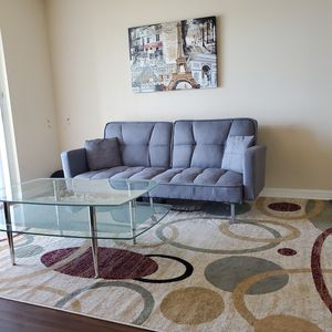 Futon, Rug, modern coffee table, TV stand, painting, dinner table Must GO for Sale in Tamarac, FL