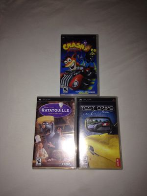 PSP Games: Crash Tag Team Racing, Test Drive Unlimited, Disney Ratatouille Complete With Booklets Discs In Great Condition $7 Each Game for Sale in Reedley, CA