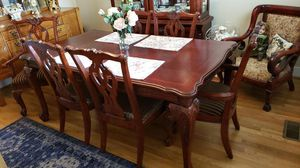 Cherry wood dining room table with 6 chairs, glass shelves and drawers China cabinet. Does not include items inside hutch. 2195.00 for Sale in Wake Forest, NC