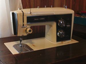 Sewing machine in cabinet for Sale in Alexandria, VA