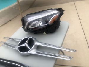2018 Mercedes Benz GLC 300 headlight 1 broken tab .. molding insert emblem has a little crack..and lower valance with chrome parts 1 have damage .. for Sale in Redlands, CA