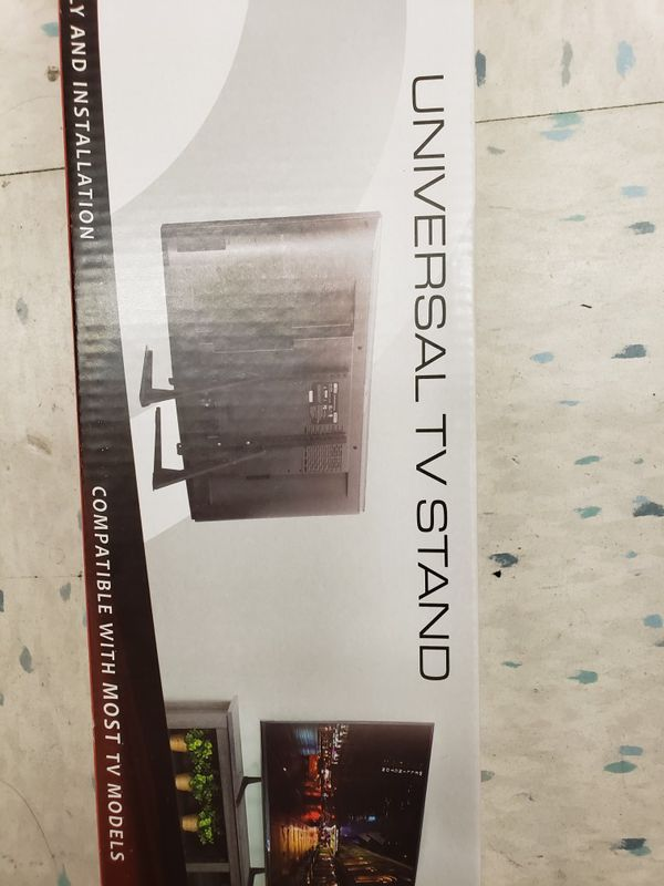 TV stand... new in box universal... 22 to 70 inches