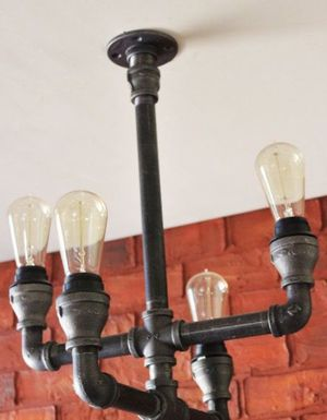 Industrial pipe hand made chandeliers for Sale in Wichita, KS