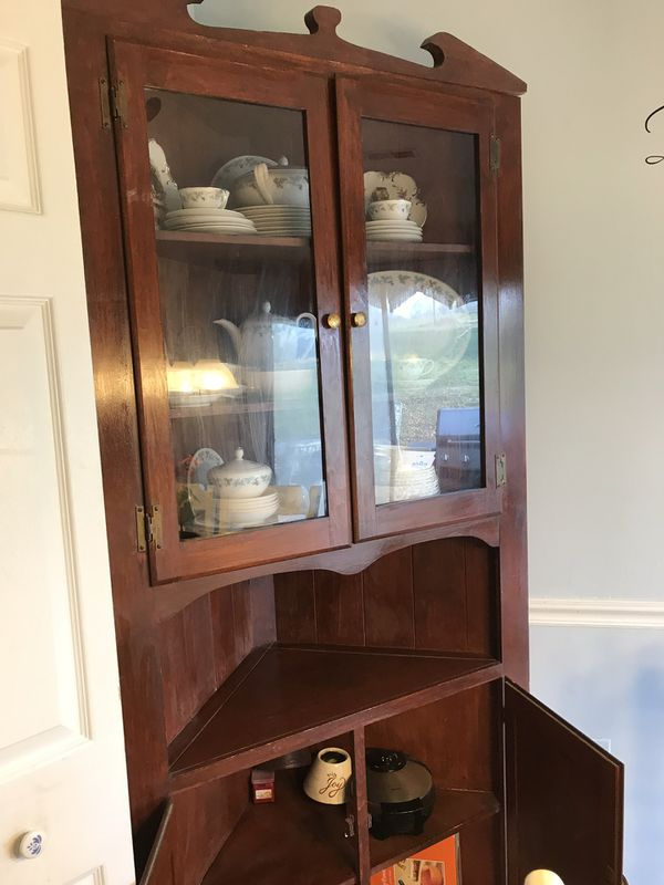 Cherry finished corner cabinet