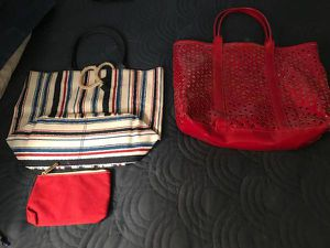 ****2 BAGS FOR SALE- LIKE NEW CONDITION**** STRIPED BAG IS CLOTH/CANVAS RED BAG IS HEAVY GOOD QUALITY PLASTIC $12 EACH OR 2 FOR $20 for Sale in San Francisco, CA