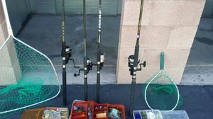 Four medium to medium large spinning rods and reels, four boxes of tackle and two fishing nets for Sale in Las Vegas, NV