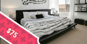 Black Genuine Leather King Platform Bed Bedframe and Headboard (1 dent shown in pic on the left sidoute of platform) for Sale in Rancho Cucamonga, CA