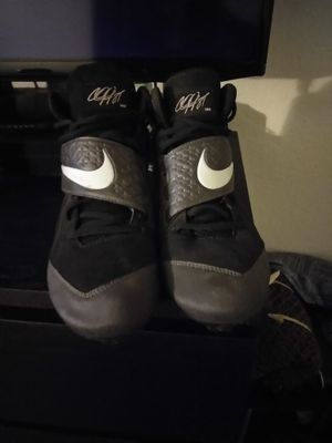 Foot ball cleats and bmx rim for Sale in Orlando, FL