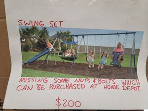 New Swing set. Missing some nuts & bolts gor assembly, can be purchased at Home Depot. $200 FIRM for Sale in Redlands, CA