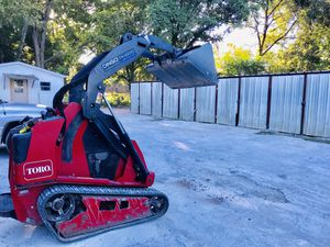 Skid steer we can help you move around gravel gravel top soil mulch gravel for Sale in Houston, TX