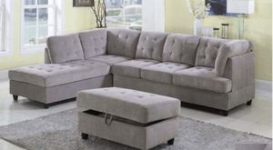 Grey sectional sofa with storage ottoman. for Sale in San Mateo, CA