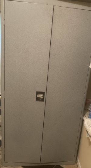 Metal cabinet like new and additional shelves for Sale in Jonesboro, GA