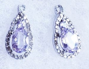 Amethyst and diamond sterling silver post earrings brand new for Sale in Pittsburg, CA