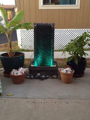 Water fountain lights and pump included. Bas22 1/2 w x 16 D x 8 H. Fountain is 39 tall for Sale in Oceanside, CA