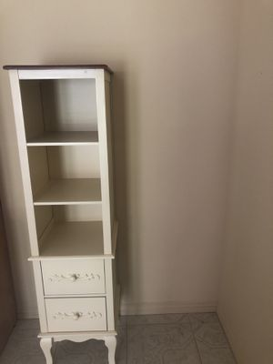Ivory shelf cabinet has 2 drawers. Very solid. for Sale in Houston, TX