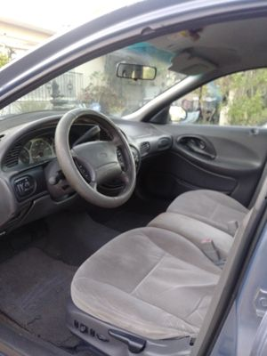 Ford Taurus 1999 air conditioned. Good motor for Sale in Orlando, FL