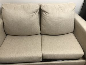 Love seat- hide away bed twin size- in great condition no rips- has been cared for well, very comfortable. for Sale in Denver, CO