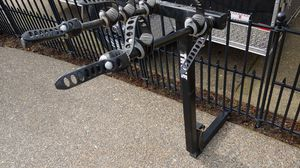 Hitch mount bike rack made by Thule holds up to 4 bicycles for Sale in Beaverton, OR