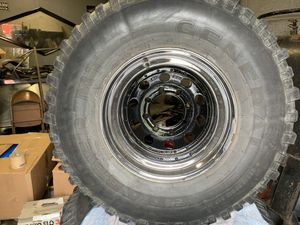 35x12.5 r16.5 tires on 8x6.5 lug black and chrome rims for Sale in Detroit, MI