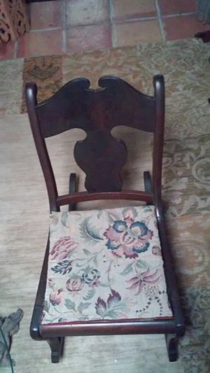 Antique solid mahogany rocking chair. Solid heavy wood. Firm on price. for Sale in Tampa, FL