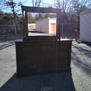 QUALITY BLACK DRESSER WITH BIG MIRROR FROM ASHLEY FURNITURE GREAT CONDITION for Sale in Fairfax, VA