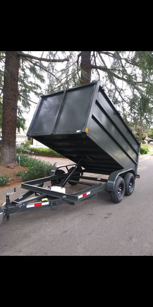 BRAND NEW DUMP TRAILER 8X12X4 12,000 LBS HYDRAULIC 12K I HAVE TITLE IN HAND FOR QUESTIONS TEXT ME PLEASE for Sale in Los Angeles, CA